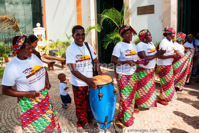 Africa, Angola, Luanda. Musicians drumming and singing outside of the Church of Our Lady of Remedies.