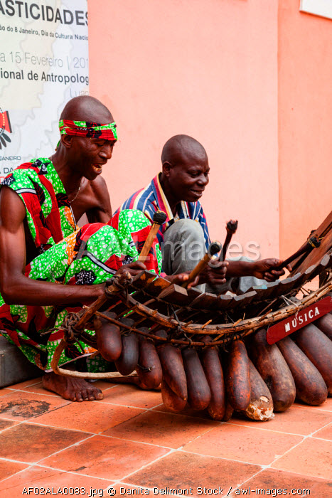 Africa, Angola, Luanda. Men playing traditional marimba xylophone.