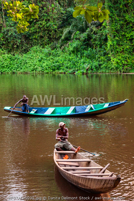 awl-images.com - Cameroon / Africa, Cameroon, Kribi. Men in traditional pirogue fishing boats.