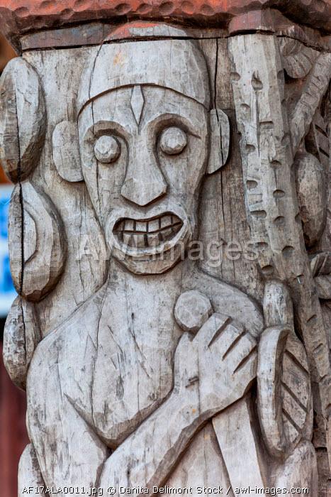 Africa, Gabon, Libreville. Wood carving by artist Zepherin Lendogno outside Nkembo Church.