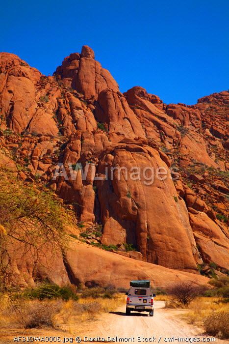 4x4 and rock formations at Spitzkoppe, Namibia, Africa.