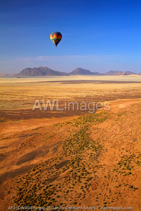 awl-images.com - Namibia / Aerial view of Hot air balloon over Namib Desert, near Sesriem, Namibia, Africa.
