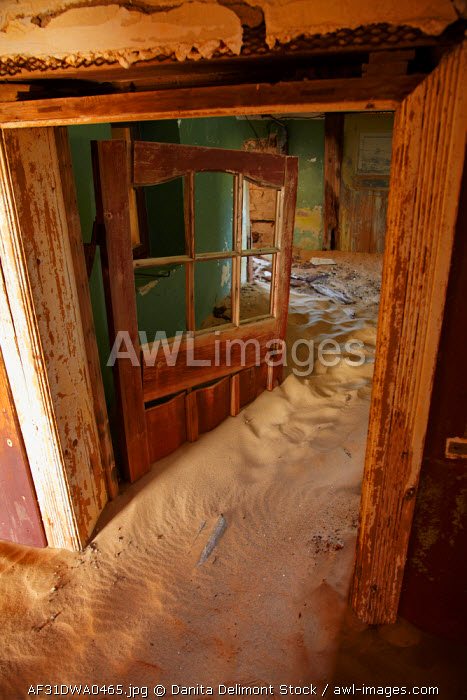 awl-images.com - Namibia / Sand and doorway inside abandoned house, Kolmanskop Ghost Town, near Luderitz, Namibia, Africa.