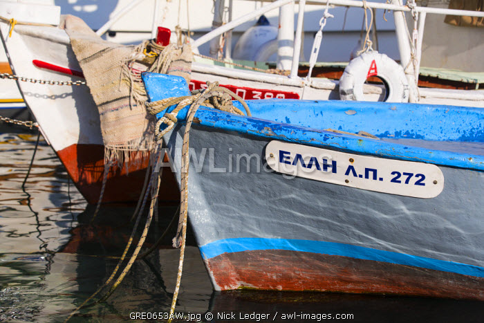 awl-images.com - Greece / Western Europe, Greece, Ionian Islands, Paxos. Traditional fishing boats in the harbour at Loggos.