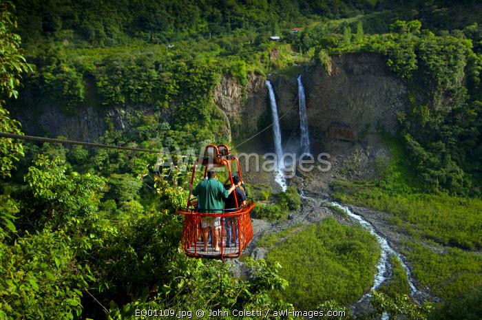 Tourists Ride A Cable Car or Tarabita Over The Rio Pastaza Valley, River Gorge, Toward The Twin Waterfalls Manto de Novia, Route of The Waterfalls, Ruta de las Cascadas, Banos, Gateway To The Amazon, Tungurahua Province, Ecuador