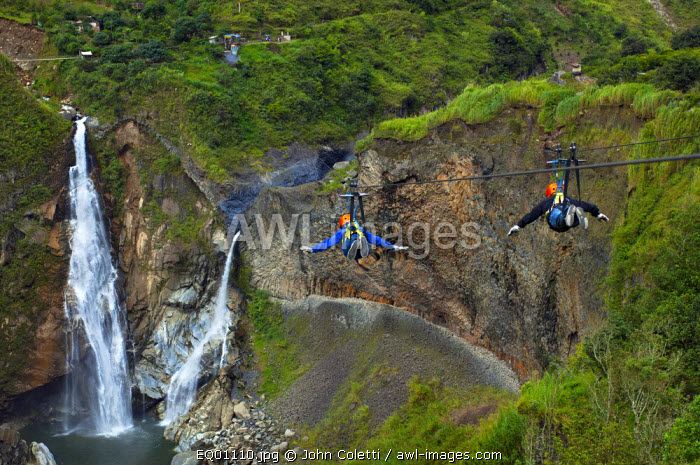 Tourists Zip Lining Like Birds Over The Rio Pastaza Valley, River Gorge,Toward The Agoyan Waterfalls, Tallest Waterfall of The Ecuadorian Andes, Route of The Waterfalls, Ruta de las Cascadas, Banos, Gateway To The Amazon, Tungurahua Province, Ecuador