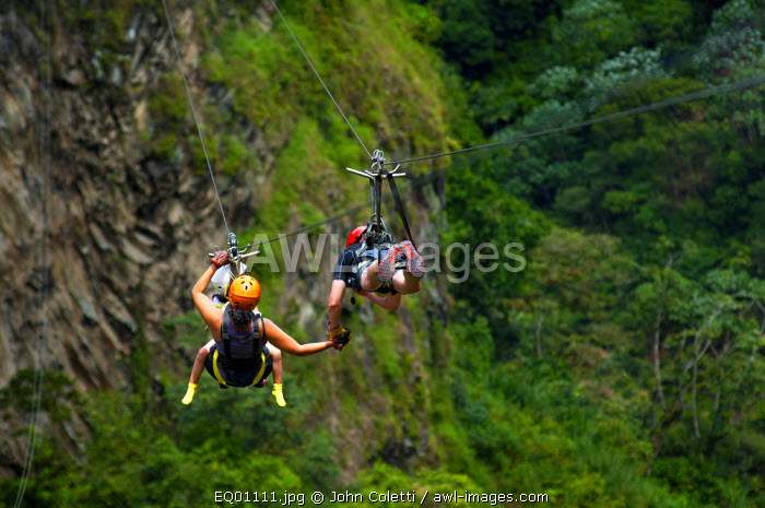 Family Zip Lining Over The Rio Pastaza Valley, River Gorge, Tourists, Route of The Waterfalls, Ruta de las Cascadas, Banos, Gateway To The Amazon, Tungurahua Province, Ecuador