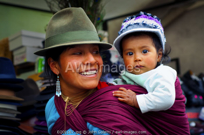 Saquisili Market, Quechuan Mother With Baby Shopping In The Market, Saquisili, Cotopaxi Province, Ecuador, Quechua is A Language Spoken By The Andean Native American, It Was The official Language of The Inca Empire, Andean Native American