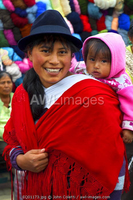 Saquisili Market, Quechuan Mother With Baby Shopping In The Market, Saquisili, Cotopaxi Province, Ecuador, Quechua is A Language Spoken By The Andean Native American, It Was The official Language of The Inca Empire