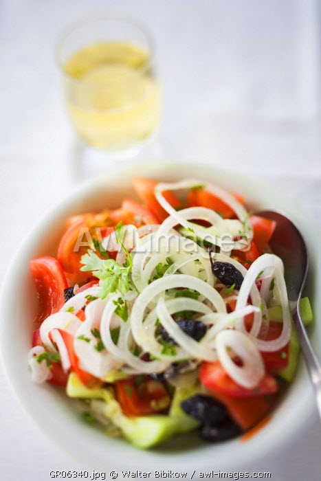 Greece, East Macedonia and Thrace Region, Kavala, Greek Salad and glass of wine