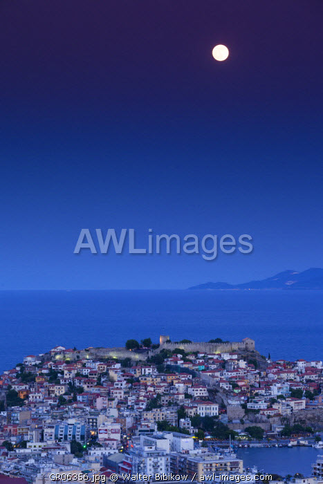 Greece, East Macedonia and Thrace Region, Kavala, elevated city view with Kastro fortress with moonrise