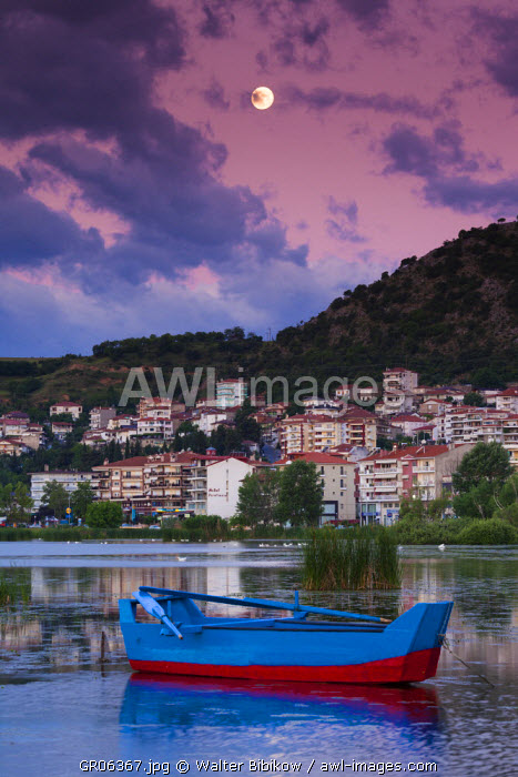 Greece, West Macedonia Region, Kastoria, town view by Lake Orestiada, dawn, with lake fishing boats