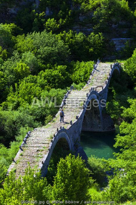 Greece, Epirus Region, Zagorohoria Area, Vikos Gorge, Ottoman-era multi-arched bridge over the Voidomatis River