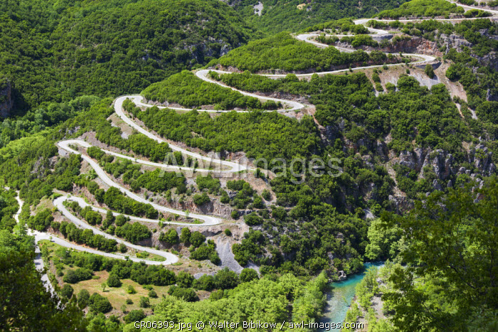 Greece, Epirus Region, Zagorohoria Area, Vikos Gorge, world's deepest gorge, elevated view of the switchback road to the Papingo Villages
