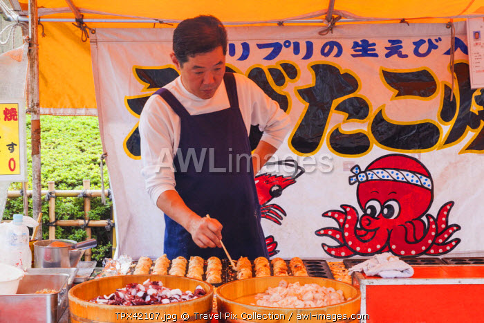 Japan, Honshu, Kanto, Tokyo, Asakusa, Sensoji Temple aka Asakusa Kannon Temple, Nakamise Shopping Street, Fast Food Seller Making Takoyaki (Octopus Balls)