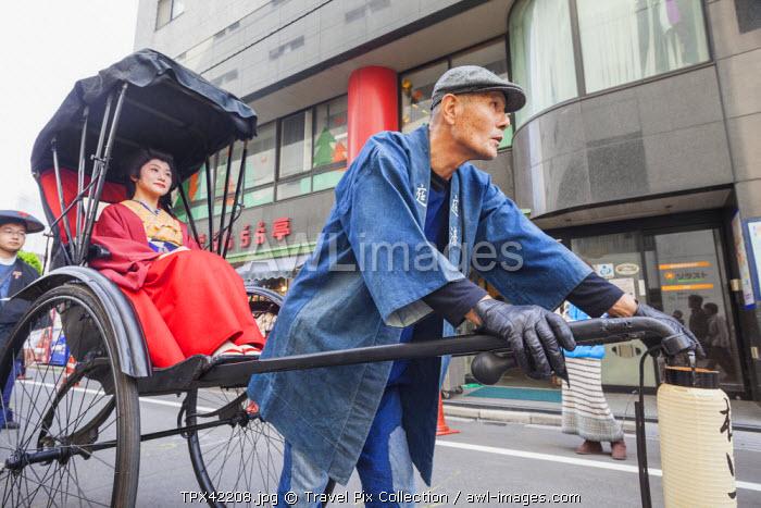 Japan, Honshu, Kanto, Tokyo, Asakusa, Jidai Matsurai Festival, Woman in Rickshaw