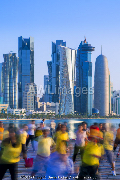 Qatar, Doha, new skyline of the West Bay central financial district of Doha, morning execrcises on the waterfront