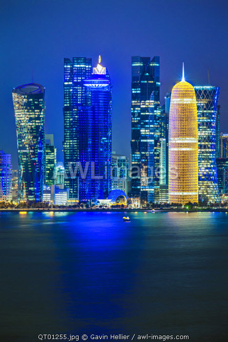 Qatar, Doha, new skyline of the West Bay central financial district of Doha, illuminated at dusk