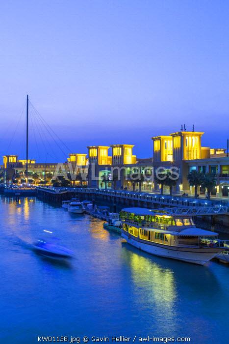 Kuwait, Kuwait City, Souk Shark Mall and Kuwait harbour, illuminated at dusk