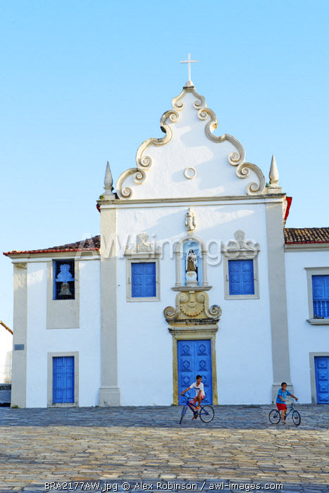 South America, Brazil, North East, Sergipe, Sao Cristovao, children riding bicycles in front of the 17th Century baroque Carmelite convent (Convento do Carmo)