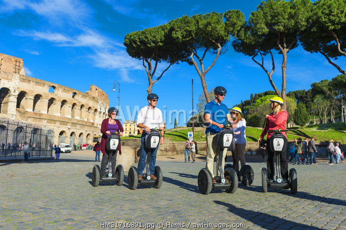 Italy, Lazio, Rome, historical centre listed as World Heritage by UNESCO, the Colosseum or Coliseum is the largest amphitheatre of the Roman Empire, built between 70 and 80 AD, tourists riding Segways