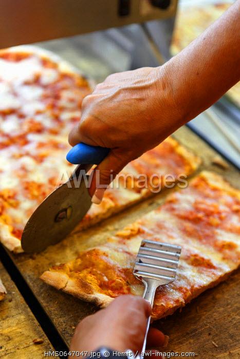 Italy, Lazio, Rome, cut of a slice of pizza