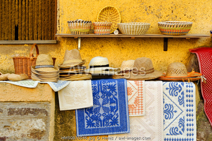 Italy, Sardinia, Sassari Province, Gulf of Asinara, Castelsardo, craft store, straw hats put on slicks and one shelf