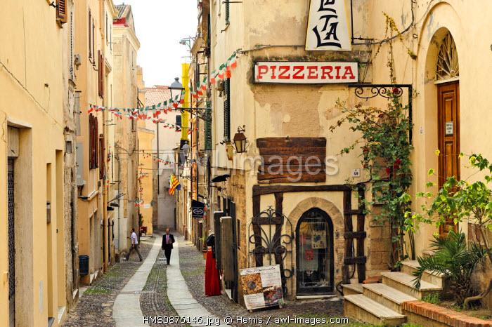 Italy, Sardinia, Sassari Province, Alghero, Via Roma, walking in a cobbled street in the historic city center