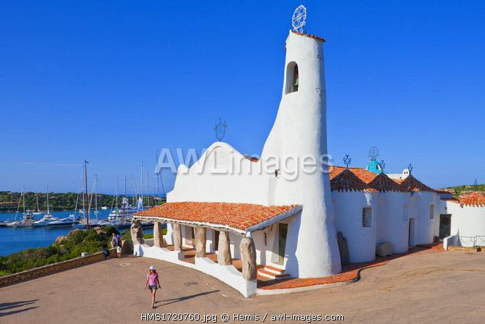 Italy, Sardinia, Province of Olbia-Tempio, the Emerald Coast (Costa Smeralda), Porto Cervo, Stella Marris church with whitewashed walls with lime and built between 1968 and 1969 by architect Michael Vici Busiri, woman