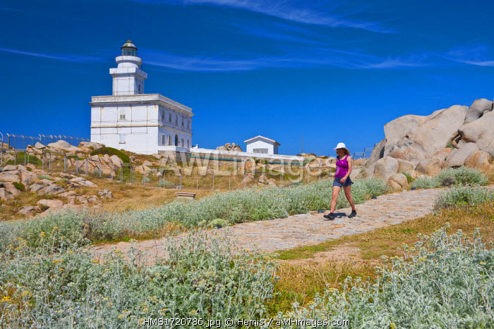 Italy, Sardinia, Province d 'Olbia-Tempio, Gallura, the granite rocks of Capo Testa and its lighthouse woman practicing hiking