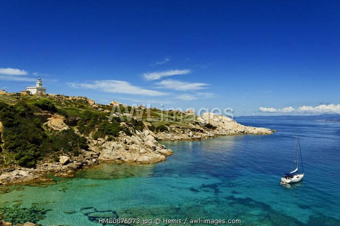 Italy, Sardinia, Olbia Tempio Province, Santa Teresa Gallura, Capo Testa, granite peninsula overlooking the Strait of Bonifacio facing Corsica, sailboat at anchor in the middle of a cove with transparent waters