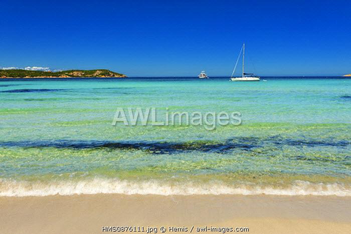 Italy, Sardinia, Olbia Tempio Province, the Emerald Coast (Costa Smeralda), Porto Cervo, Pevero beach, white sand shore on water bottom turquoise blue with a sailboat in the background