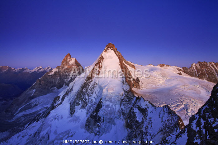 awl-images.com - Switzerland / Switzerland, Canton of Valais, Dent d'Herens (4171m) and Matterhorn in the background, from the Tete de Valpelline at sunrise