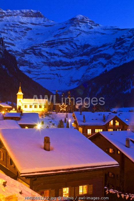 Switzerland, Canton of Vaud, Ormont Dessus, Les Diablerets village with Les Diablerets mountain chain in the background