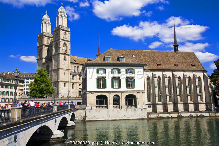 Switzerland, Zurich, on the left, the Protestant Grossmunster Cathedrak of Romanesque style and the gothic church of Wasserkirche on the Limmat River Bank