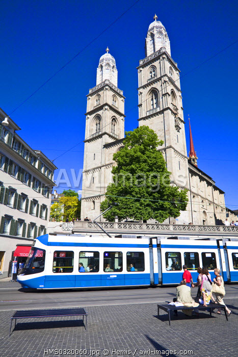 Switzerland, Zurich, right bank of the Limmat River, the tram and the twins towers of the Protestant cathedral of Grossmunster