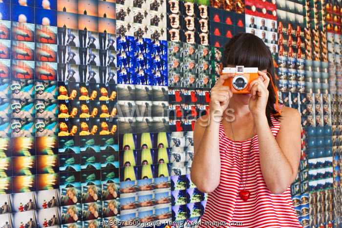 Vienna, Austria, MuseumsQuartier (MQ), Lomography shop, the world's first Lomography store opened in 2001 by the camera brand Lomography, a type of camera made in the 1980's in the USSR, and relaunched in Vienna, a photographer in front of a PhotoWall