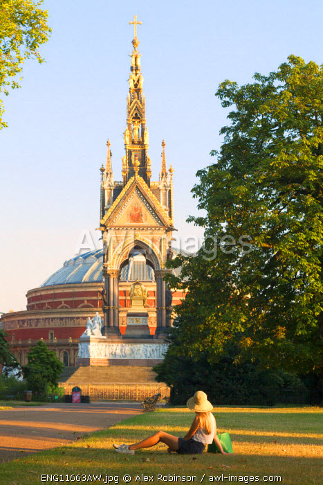 Europe, United Kingdom, England, London, Kensington, an attractive young woman in a hat sitting in front of the Albert Memorial in Kensington Gardens MR