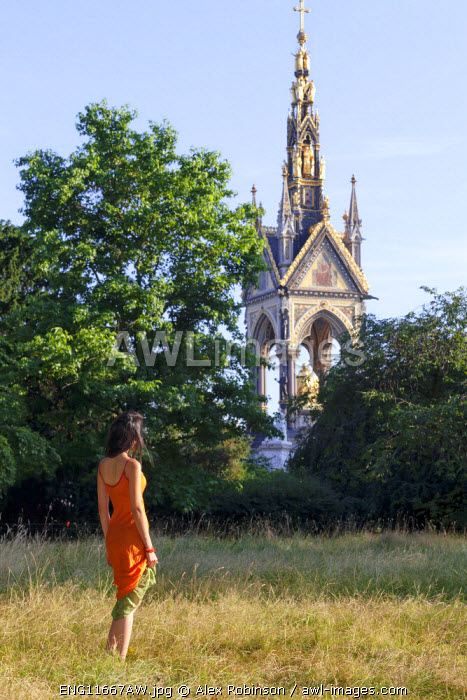Europe, United Kingdom, England, London, Kensington, an attractive young woman standing in front of the Albert Memorial in Kensington Gardens MR