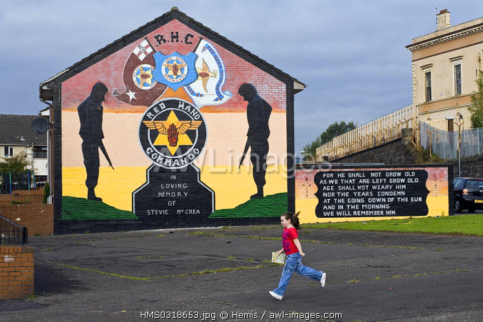 United Kingdom, Northern Ireland, Belfast, protestant loyalist districts of Shankill and political wall painting, young girl running