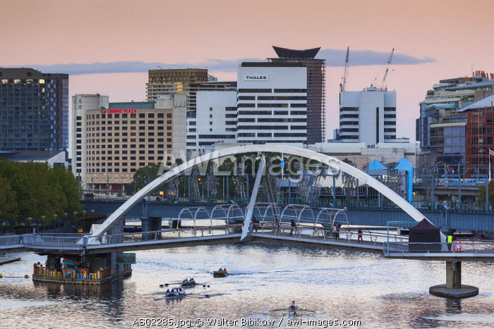 Australia, Victoria, VIC, Melbourne, Southbank, Yarra River footbridge and rowers, dawn