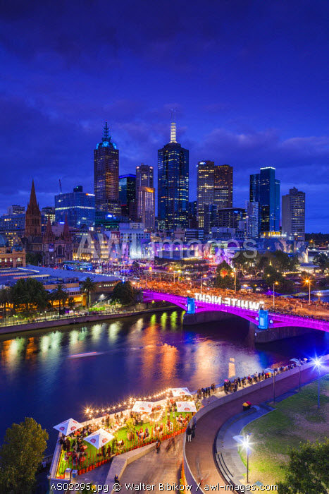Australia, Victoria, VIC, Melbourne, White Nights Festival, buildings lit with projected laser designs, city skyline and Federation Square, elevated view