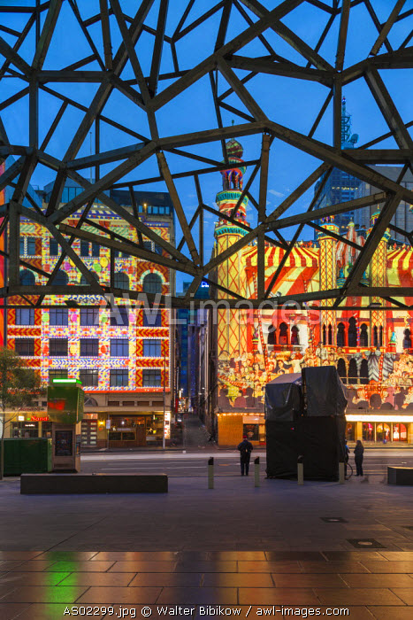 Australia, Victoria, VIC, Melbourne, White Nights Festival, buildings lit with projected laser designs, view from Federation Square