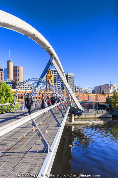 Australia, Victoria, VIC, Melbourne, Yarra River footbridge and skyline, morning