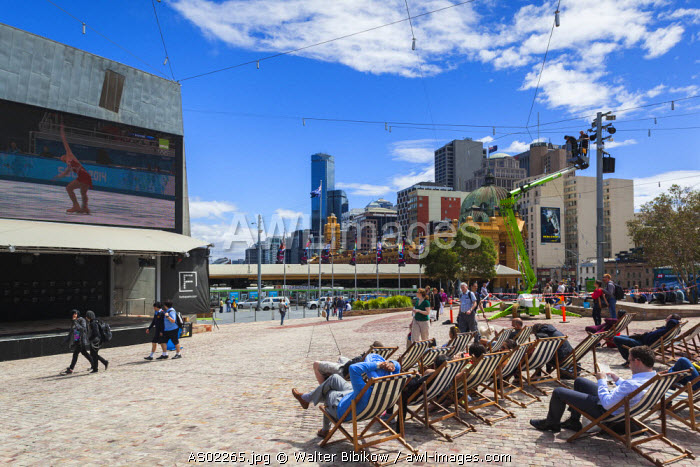 Australia, Victoria, VIC, Melbourne, Federation Square, watching the Olympics, NR
