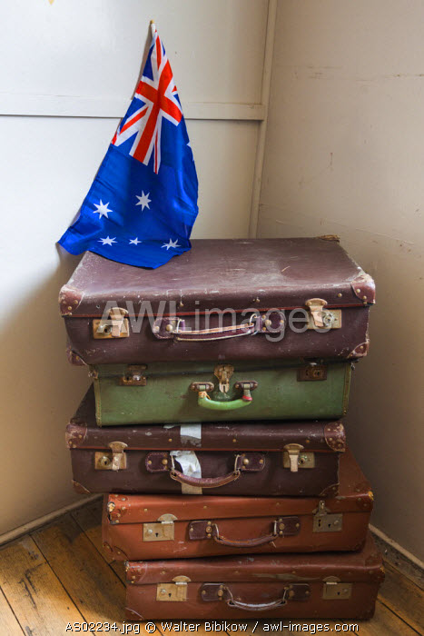 Australia, Victoria, VIC, Bonegilla, The Bonegilla Migrant Experience Museum, post-WW2 immigrant facility, housing barracks interior, luggage and Australian flag