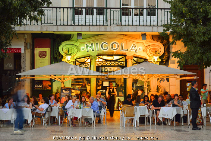 Nicola Cafe at twilight, a historic cafe in the famous Rossio Square. Lisbon, Portugal