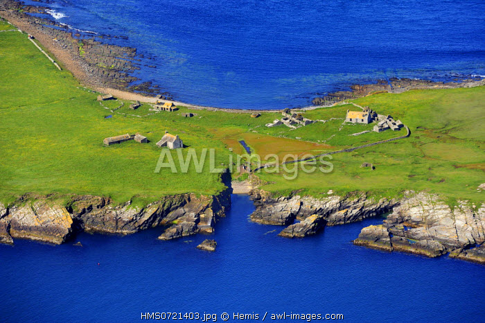 United Kingdom, Scotland, Orkney Islands, ruins of former houses on the small uninhabited island of Swona (aerial view)