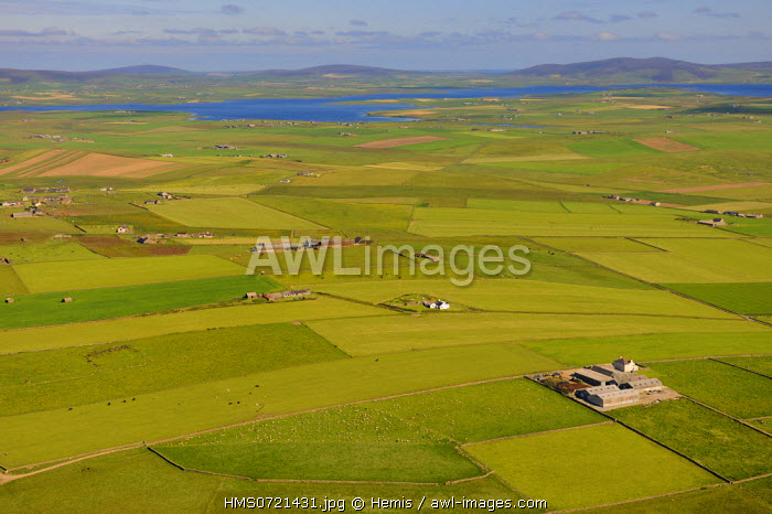United Kingdom, Scotland, Orkney Islands, Isle of Mainland, fields and farms scattered on the east coast (aerial view)