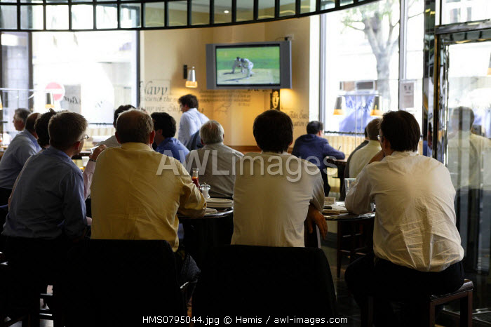 United Kingdom, London, businessmen of the City looking at a match of cricket in a restaurant